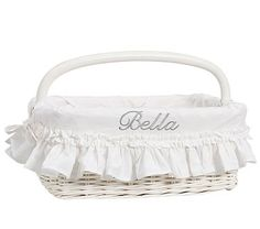 White Ruffle Nursery Storage #pbkids One with handle for end table, long basket for changing table. Need to figure out how to add some color to the liner- maybe add ribbon? or just embroider with color?