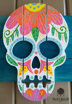 Day of the Dead is rapidly approaching. To prepare, I created a painted wood sugar skull trio, for my front porch. I love bright and colorful decorations for Day of the Dead. #decoartprojects #decoartmedia