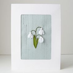 This card is all about celebrating the arrival of spring and new beginnings. I have hand embroidered a trio of pure white snowdrops in silk ribbon and
