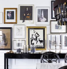 Decorating with Art.  High contrast gallery wall with black console table against white wall. Interior Design: Marianne Brandi and Keld Mikkelsen.