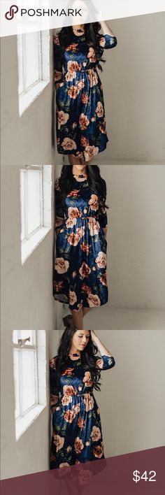 High Neck Velvet Floral Midi Dress - Navy 3/4 sleeve high neck fit and flare dress in a soft and stretchy velvet. Pockets! I am 5'9 wearing a size small. Small (0-4) Medium (4-8) Large (8-12) XL (12-16) 95% polyester 5% Spandex. Made in USA. Dresses Midi