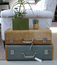 vintage luggage stacked as an end table. So cute!