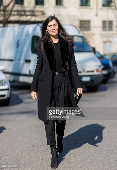 Emmanuelle Alt wearing black coat outside Armani during Milan Fashion Week Fall/Winter 2017/18 on February 27 2017 in Milan Italy