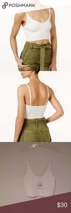 Free People Cropped Ribbed Camisole Worn alone or as a layer this cropped camisole packs a lot of style.  Cotton/Nylon/Spandex Hand wash. V-neckline. Pullover style. Cropped and fitted. Hits at waist. Free People Tops Crop Tops