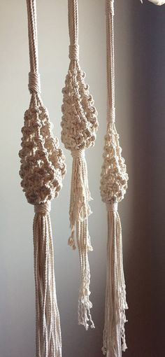Lovely Hanging Macramé Baskets! So adorable and can be used for so many things including holding an Air Plant or mini-pot with a cactus, miniature fern, the list goes on! They would fit wonderfully in a Boho Hippie Decor. These are made with 100% cotton rope. I only use natural fibers, no poly cord for me :). This listing is for one of the above and is a made to order item. The basket on all of them is 8 high by 3 across and the opening is 5 high. The lengths are as follows, please convo me…