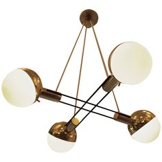 Striking Stilnovo Four Large Globes Chandelier | From a unique collection of antique and modern chandeliers and pendants  at https://www.1stdibs.com/furniture/lighting/chandeliers-pendant-lights/