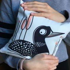 """Celebrate spring with our """"Common Loon"""" pocket pillow. Handmade, two sizes or with either a wool or linen back fabric. Cushion Covers, Pillow Covers, Pure White Background, Hidden Spaces, Large Cushions, Hiding Spots, Pink Highlights, Pillow Forms, Tooth Fairy"""