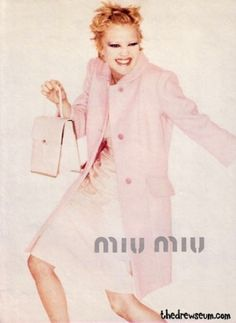Giving us her best sneaky pose. | Drew Barrymore's Gorgeous 1995 Miu Miu Ad Campaign