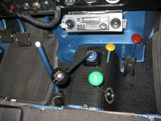 blue and white parking brake, black shifter, yellow transfer case,  red select high or low. Green overdrive