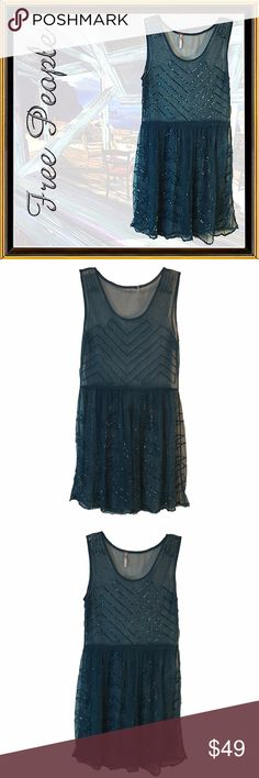FREE PEOPLE Blue-Beaded-Sleeveless Dress - Size SP CONDITION - EXCELLENT  Features:  Highly detailed bead work See through and completely teal Hemline trimmed in beads Beads look like iridescent teal baguette beads  Fabric: Synthetic - Tags has been removed because they would have been seen when worn  Care: Hand wash. Lay flat to dry.  Measurements are in inches. Shoulder:  12 Chest:  30 Waist:  26 Hips:  38 Length from shoulder: 32 Sleeve Length: N/A Free People Dresses Mini