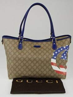 The Gucci Beige/Blue GG Coated Canvas American Flag UNICEF Joy Tote Bag is big enough for all that we need to carry. This sleek bag features durable GG coated canvas with bright blue smooth leather trim, larger American flag printed interlocking GG on the coated canvas. A patriotic and fun tote bag for everyday wear.