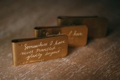 A vintage money clip hand-engraved with a ee cummings quote.