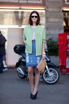 A distressed jean skirt adds street cred to her otherwise ladylike ensemble, Milan Fashion Week Fall 2013 | Harper's Bazaar Street Style