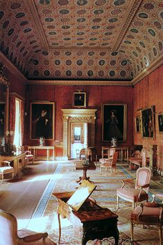 Syon House ~ red drawing room - Emma was filmed here. The Red Drawing Room is decorated with luxurious crimson Spitalfields silk brocade, which greatly enhances the series of Stuart royal family portraits displayed on the walls [2]. There include portraits of Charles I, his wife Henrietta Maria, his daughter Henrietta, his second son the Duke of York, and his first son Charles II with his wife Catherine of Braganza.