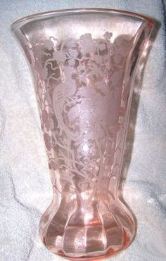 This is a beautiful pattern Pattern: Peacock and Wild Rose Depression Glass, is also known as Nora Bird and Line #300 Manufacturer: Paden City Glass Company Dates Manufactured: 1929 - 1930s Colors: Pink, Green, Amber, Cobalt Blue, Black, Light Blue, Crystal Clear and Red