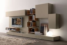 We like the modern style of this wall unit, but it's a little too big. Maybe get rid of the modular boxes on the right side.