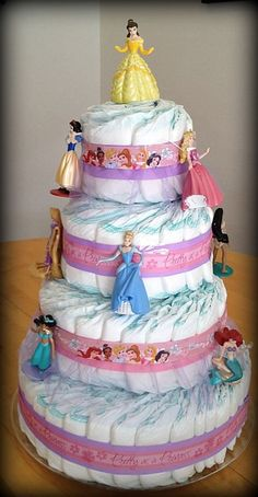 Disney Princess Diaper Cake (My sixth diaper cake. Made for my finance's boss's wife. The baby's name is Belle. ) This one was also 4 tiers!