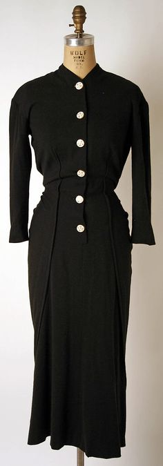 Dress, Dinner.  Elsa Schiaparelli (Italian, 1890–1973).  Date: ca. 1938. Culture: French. Medium: wool, porcelain, metal. Dimensions: Length at CB: 55 in. (139.7 cm).
