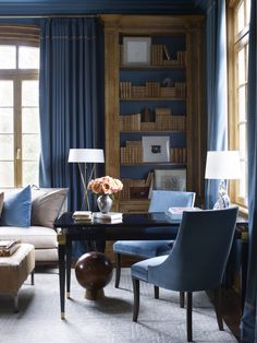 """We love the rich blue against the natural wood in the library, complemented by the room's natural light. Photography by Erica George Dines, courtesy of """"Suzanne Kasler: Timeless Style,""""  Rizzoli 2013"""