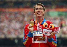 Gold medalist Sergey Shubenkov of Russia poses on the podium during the medal ceremony for the Men's 110 metres hurdles final during day eight of the 15th IAAF World Athletics Championships Beijing 2015 at Beijing National Stadium