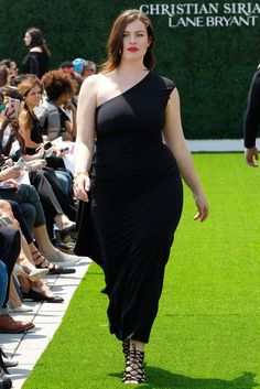 Spring and summer style inspiration from model Georgia Pratt who walked in the Christian Siriano for Lane Bryant Show. She wore a black, one-shoulder jumpsuit with lace up sandals and a bold red lip.