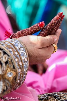 The Bride and groom hold hands at the wedding ceremony to signify unity forever.