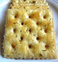 Ingredients First you need one 1/2 sticks butter, melted And one packet ranch dressing mix Then two T. red pepper flakes 1/2 tsp. garlic powder Also two sleeves saltine crackers and finally parmesan cheese How to Make It First step to prepare this