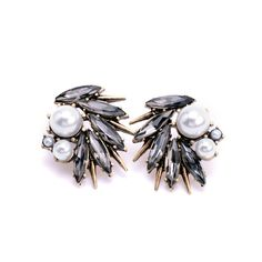 """This piece is intriguing and screams mystery and otherworldly charm. Its a must have!""  PRODUCT CODE- AW 01 Classic pearls with black spikes #earrings #pearl #fusion #spikes #blackstone #jewelery #jewellery #mattegold #gold #india Contact us at (only available in India) :- +91- 81300-71170 info.artwear@gmail.com"