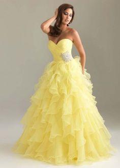 Vestido longo amarelo com brilhos laterais em forma de flor.  Lindoooo!!