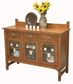 The Amish Glenwood Glass Sideboard is a beautiful handcrafted piece of furniture that will make a great accent piece for your home.
