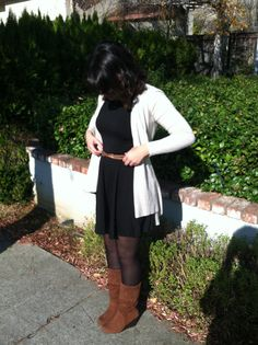 Thanksgiving outfit. Little black dress, brown belt, creme cardigan, brown boots, curly hair. Women's fashion.