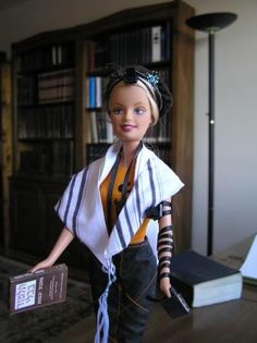 Not so excited about the Barbie in tefillin BUT this website has some good ideas of what to do on Chanukah other than give gifts.