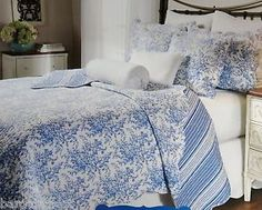 Set Includes: King Quilt 2 Shams (see below for sizing). Pieced floral fabrics in cornflower blue, sky blue, navy blue and white. Accented with a large scalloped border and reverses to a coordinated blue micro floral. French Fabric, Scalloped Edge, Floral Fabric, French Country, Comforters, Blue And White, King, Quilts, Blanket