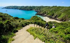 On of the many sandy bays and coves around the coast of Guernsey