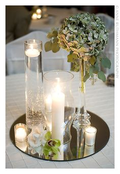 Wedding decorations and wedding table decorations for your special wedding day. Selection of place card holders, candles, wedding centerpieces, wedding centerpiece mirrors, and other wedding decorations. Hurricane Centerpiece, Mirror Centerpiece, Floral Centerpieces, Table Centerpieces, Hurricane Candle, Centerpiece Ideas, Mirror Wedding Centerpieces, Christmas Centerpieces, Graduation Centerpiece