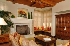 Traditional style living room with fireplace and vaulted ceilings.