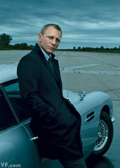 DANIEL CRAIG Photographed by Annie Leibovitz, with a vintage Aston Martin, in New York City, 2012.