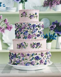 A lilac four-tier cake piped with pretty violets.