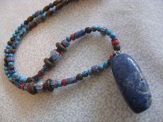 Tribal blue lapis beaded necklace by Boho Rain, via Etsy.