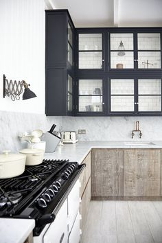 rustic   modern kitchen // Blakes London  note the subway tiles as cabinet back...the textures...the black-white contrasts...the beautiful countertop