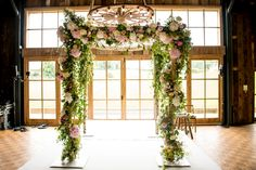 A rustic Jewish wedding with blush florals at Soho Farmhouse in Oxfordshire, UK | Smashing the Glass | fairytale floral chuppah