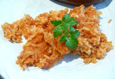 Leftover Rice Made Into Spanish Rice  3 cups cooked rice (leftover white or brown) 1 tablespoon olive oil 1 tablespoon butter 1/2 onion, diced 4 minced garlic cloves 1/2 cup tomato sauce (or more) 1/4 cup water 1/4 teaspoon coriander salt and pepper