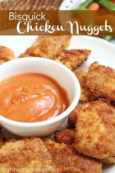 """BAKED chicken nuggets that are battered with Bisquick. 3 boneless skinless chicken breast halves cut crosswise into 1/2"""" strips (I cut them smaller to make nuggets rather than strips... cause I'm still a kid-ish) 2/3 cup Bisquick mix 1/2 cup grated parmesan cheese 1/2 tsp garlic salt 1/2 tsp paprika 1 egg, slightly beaten 3 Tbsp butter or margarine, melted"""