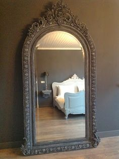 Gorgeous mirror! Love how the bedding looks against the dark wall.