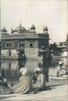 Sri Durbar Sahib Amritsar(GoldenTemple) and Sacred Lake.1927CE. One can see a part of Church that existed behind the clock tower.Now no more there.