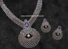 Enchanting diamond haram in chandbali design pendant with a pearl drop in the middle and glorified with sapphire stone. Paired with adorable diamond earrings with sapphire stone. Diamond Necklace Simple, Diamond Choker, Diamond Bangle, Diamond Pendant, Emerald Diamond, Diamond Jewellery, Indian Jewellery Design, Indian Jewelry, Jewelry Design