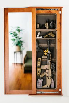 Cherry Frame w/ Mirror Cover (Open) and Black Insert. Great place to store airsoft gear. Hidden Gun Storage, Weapon Storage, Airsoft Storage, Hidden Gun Safe, Secret Storage, Safe Storage, Hidden Gun Cabinets, Tactical Wall, Hidden Rooms