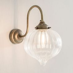 Shopping for glass lights? Try our wall mounted, brass Mia Wall Light, with hand blown glass shade for industrial or modern country feel to your bedroom, living room & kitchen diner.