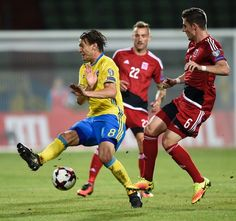 Luxembourg's midfielder Chris Philipps (R) vies with Sweden's defender Ludwig Augustinsson during the FIFA World Cup 2018 football qualification match between Luxembourg and Sweden at Josy Barthel stadium on October 7, 2016 in Luxembourg.. / AFP / JEAN-CHRISTOPHE VERHAEGEN