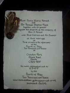 Vintage, parchment, hand written, calligraphy wedding invite with brown button and pheasant feather detail